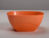 Plato profundo plástico anaranjado Foto de archivo libre de regalías
