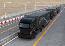 Platoon driving of autonomous hybrid trucks driving on highway Royalty Free Stock Photography