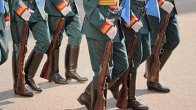 Platoon of soldiers of military army marches in arms on the street slowmotion. Platoon military army marche street slowmotion. Parade military men demonstrate stock video footage