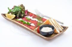 Platos de la cocina internacional en un restaurante Imágenes de archivo libres de regalías