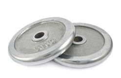 Plats de barbell en métal d'isolement Image libre de droits