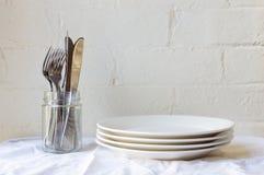 Plats de couverts et de dîner Photographie stock libre de droits