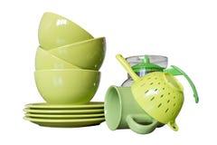 Plats de porcelaine verts d'isolement sur le blanc Photo stock