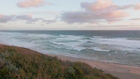 Plats för Australien strandsolnedgång, Mornington halvö lager videofilmer