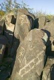 Plats för Petroglyph för tre floder nationell, byrå för a (BLM) av landledningplatsen, särdrag en bild av ett Eagle huvud, en av  Fotografering för Bildbyråer