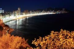 plats för strandbenidorm natt arkivbilder