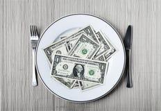 Platta av dollar Arkivfoto