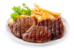 Platta av grillad meat med småfiskar Arkivfoton