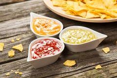 Platta av nachos med olika dopp Royaltyfria Foton