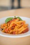 platta av pasta som isoleras på vit Royaltyfria Foton