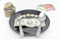 Platta av pengar Arkivfoto