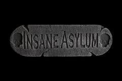 Platta för sinnessjuk asyl för dörren royaltyfri bild