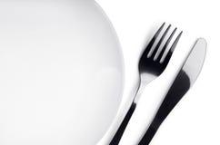 Platta, gaffel och kniv fotografering för bildbyråer