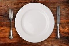 Platta, gaffel och kniv royaltyfria foton