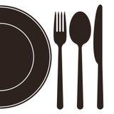 Platta, gaffel, sked och kniv Arkivfoto
