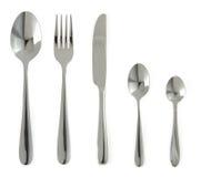 Platta, kniv och gaffel på vit Arkivfoton