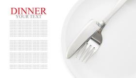 Platta med gaffeln och isolerad kniv Royaltyfria Bilder