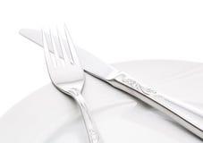 Platta med gaffeln och kniven Royaltyfria Foton
