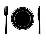 Platta med kniven och gaffeln. Royaltyfri Fotografi