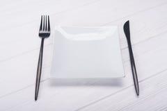 Platta med kniven och gaffeln Royaltyfria Foton