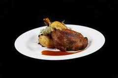Platta med mat på en svart bakgrund royaltyfri foto