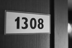 Platta med numret 1308 Arkivfoto