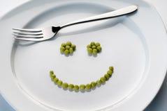 Platta med Smiley från ärtor Royaltyfria Foton