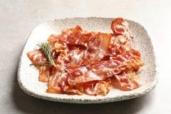 Platta med stekt bacon arkivfoto