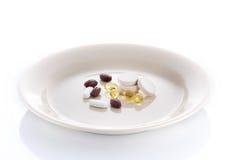 Platta med vitaminpreventivpillerar Arkivfoton