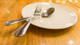 Platta, sked och gaffel Royaltyfria Foton