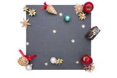 Plattan av kritiserar med julobjekt Arkivfoto