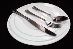 Plattaskedgaffel och kniv Arkivbild
