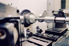 Plattasnurrmaskin i fabrik Fotografering för Bildbyråer