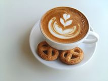 PLatte art coffee and cookies so delicious on white. Latte art coffee and cracker so delicious on white Royalty Free Stock Images