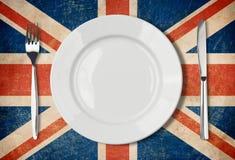 Platte, Gabel und Messer auf BRITISCHER Flagge Lizenzfreies Stockfoto