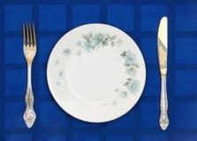 Platte, Messer und Gabel Stockfoto