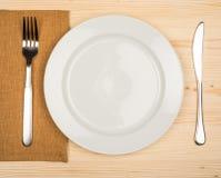 Platte, Messer und Gabel Lizenzfreie Stockfotos