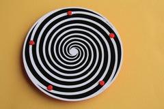 Platte mit hypnotischem Strudel Stockfotografie