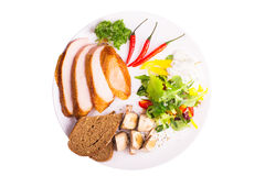Platte mit Salat, gebratene Pilze Lizenzfreies Stockbild
