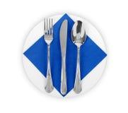 Platte mit Serviette, Messer und Gabel Stockbild