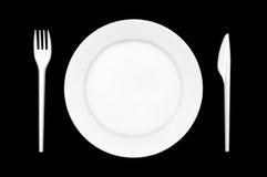 Platte mit Tischbesteck Stockbild