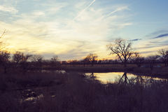 The Platte River in Nebraska at Sunset. A view of the Platte River in Nebraska at sunset. This was taken just as winter was ending and spring was beginning Stock Image