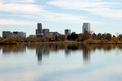 Platte River Town. Denver's skyline with Sloan's lake in foreground on a beautiful calm autumn day Royalty Free Stock Images