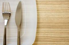 Platte und Tischbesteck Stockfoto