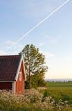 Plattelandshuisje en gebied. Stock Foto