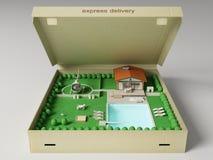 Plattelandshuisje met land in de doos Royalty-vrije Stock Foto's