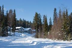 Plattelandshuisjes in de winter Stock Foto's