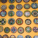 Platten auf der Wand Stockfotografie