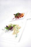 Platten der feinen speisenden Mahlzeit Stockfotos
