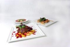 Platten der feinen speisenden Mahlzeit Lizenzfreies Stockbild